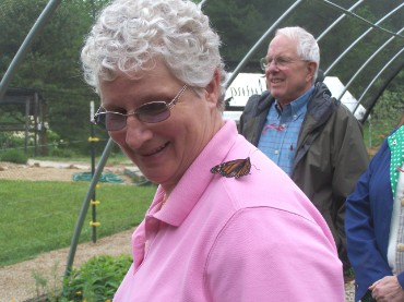 Miss Kathy  has a butterfly on her shoulder